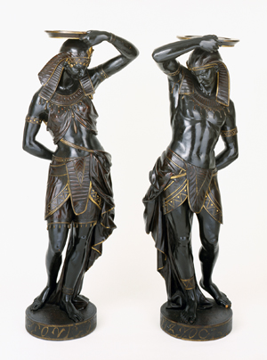 Pair of figural torcheres