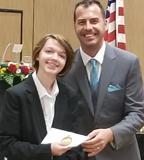 Caeli receiving award cropped
